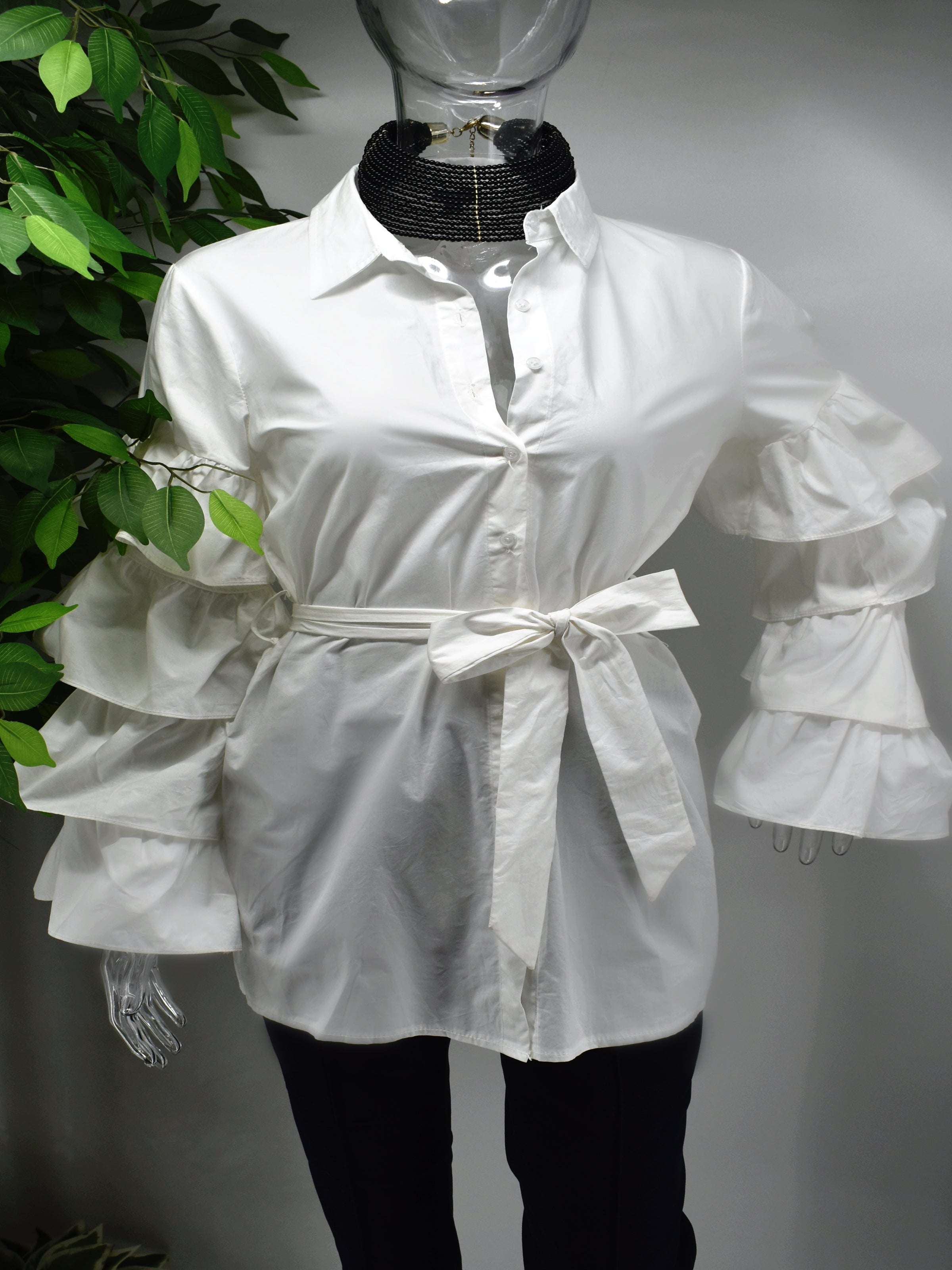 Turn heads and represent how fashionably fierce you are in our Brandis White ruffle sleeve shirt top.  Our Brandis is a long button front shirt top with a traditional collar and a romantic bold four tiered ruffle sleeve.