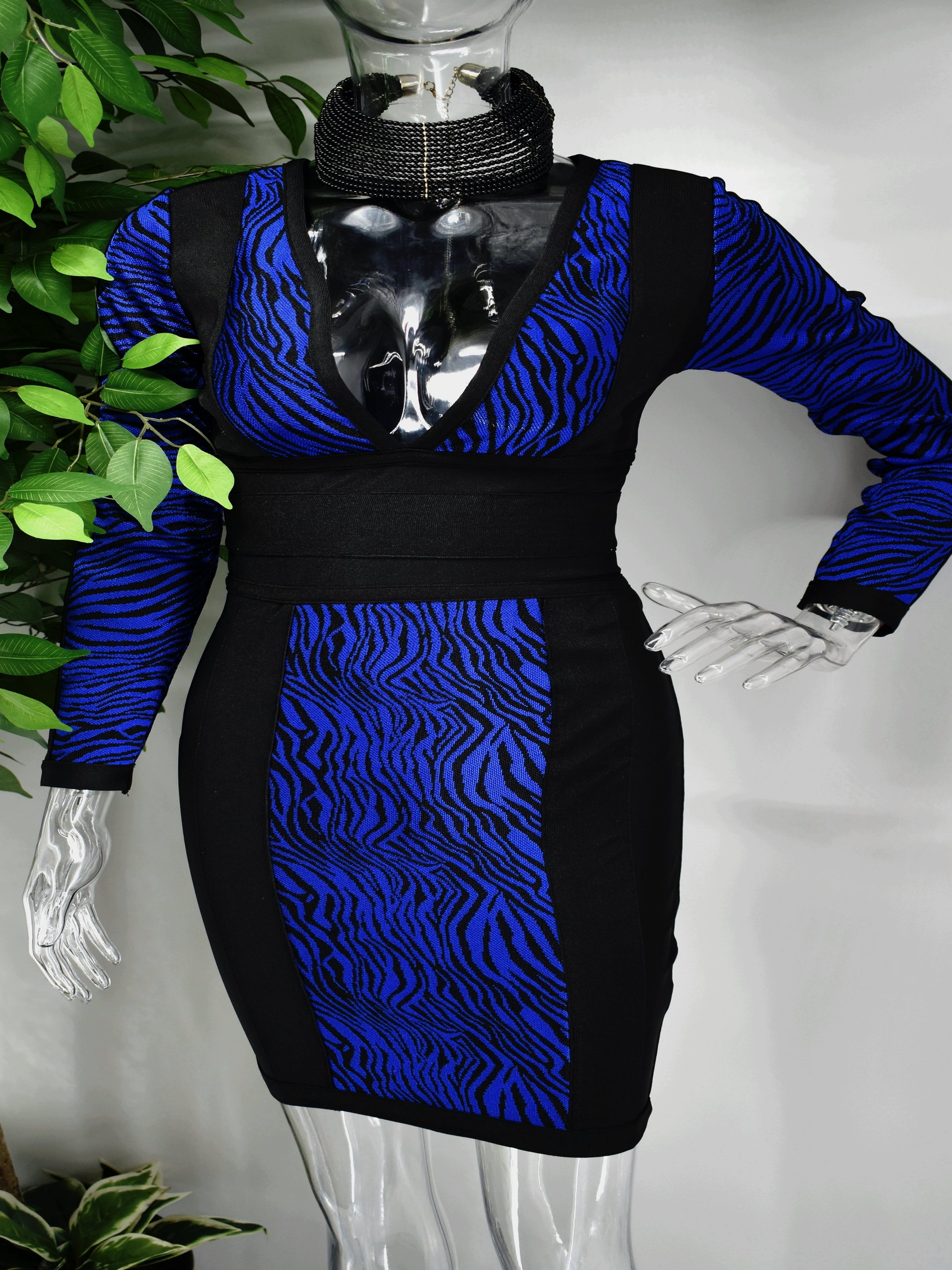 Our Bridgette Bandage dress brings that exotic vibe and is perfect for a night out. The bold blue and black tiger print centers this beauty which has a fitted bodice, long sleeves, and a plunging v-neck line. It is supported by a cinched waist and a fitted skirt which lands above the knee.