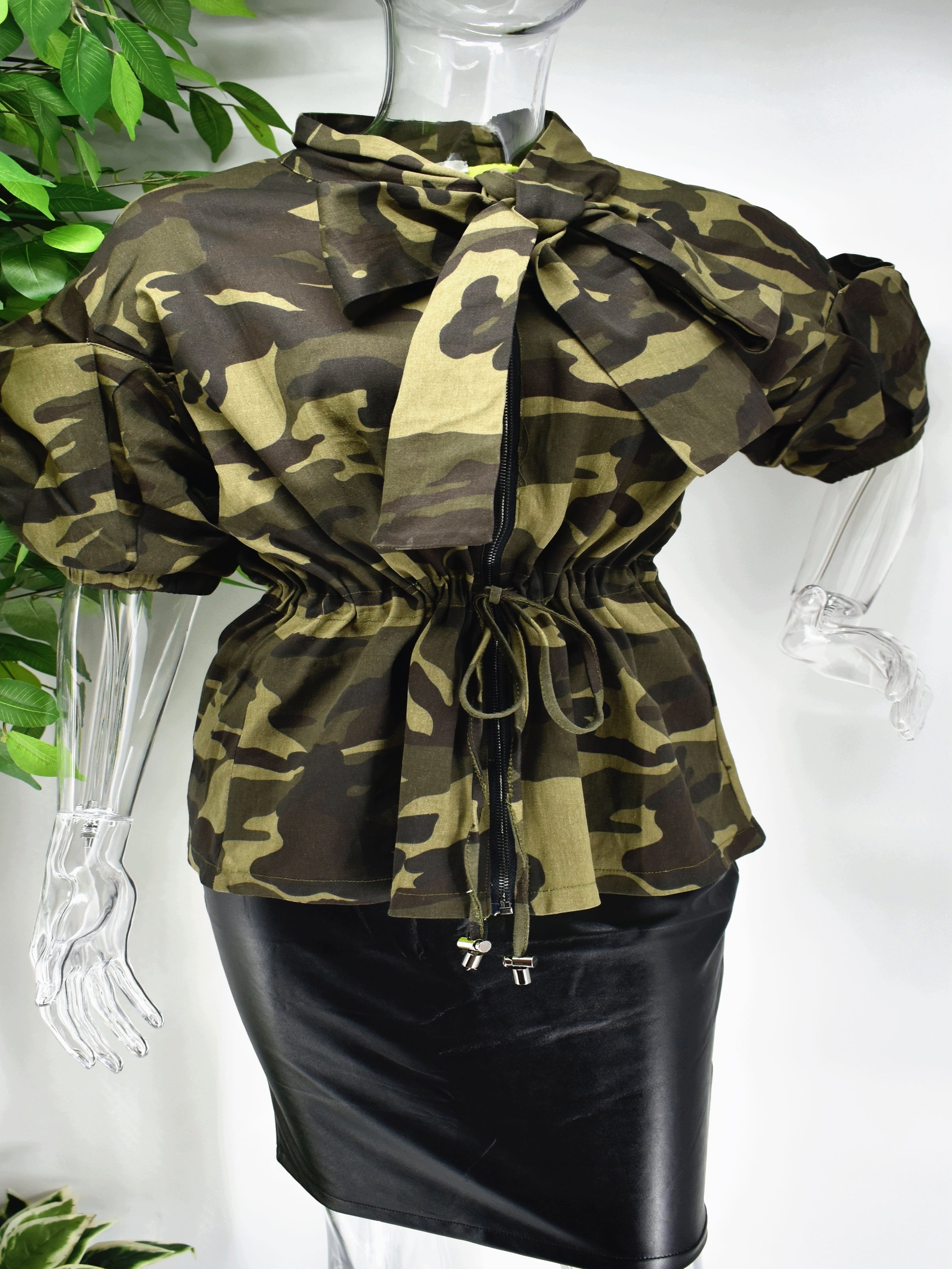 Different and irreplaceable is the words you would use to describe our Burma  camouflage top. Our Burma camo top is so unique. It has a cinched draw string waist and a unique puffed sleeve to add some drama to this classic color staple.
