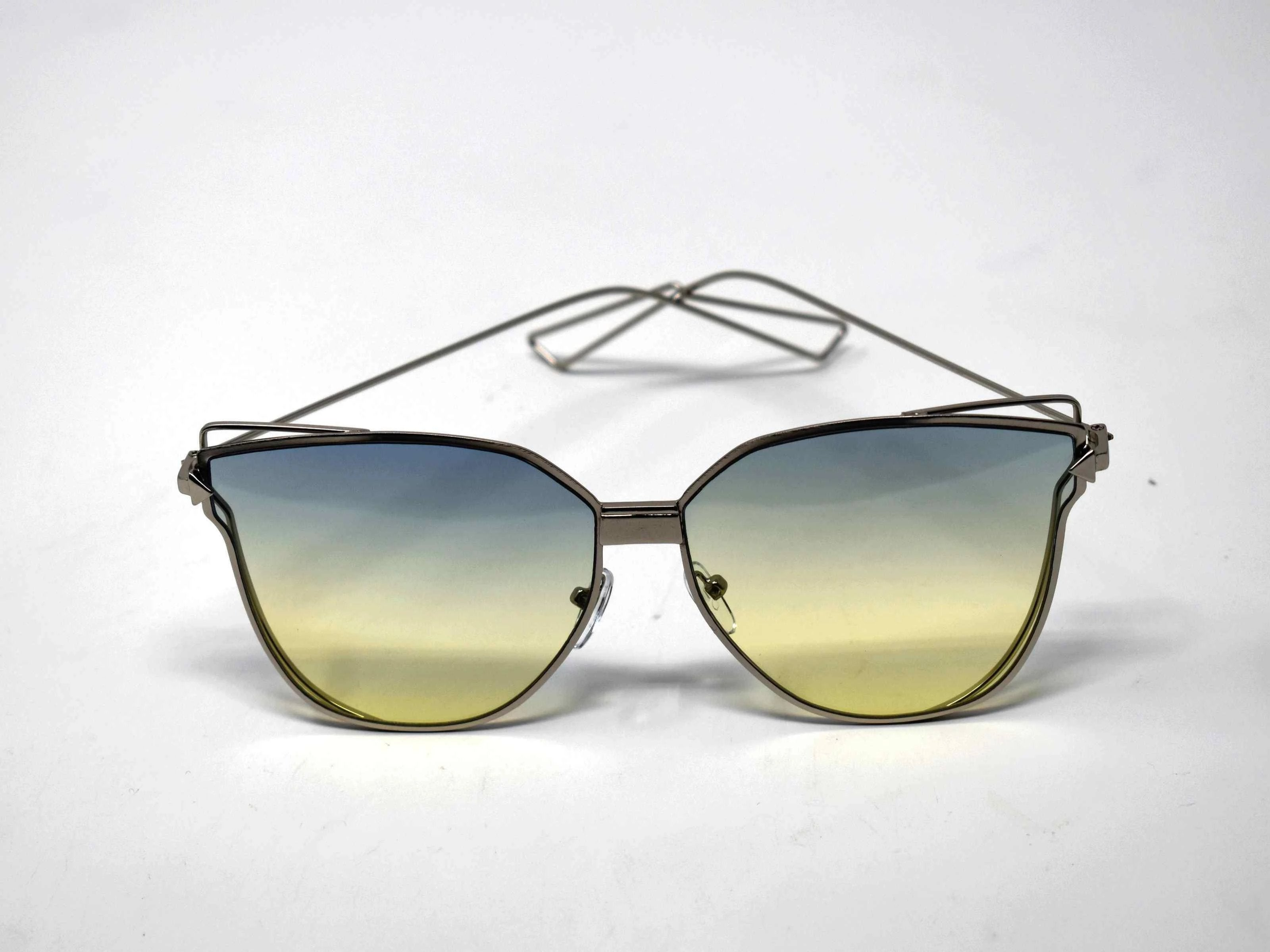 A certified stunner is what they will call you in our Camellia silver butterfly framed glasses with green ombre lens.