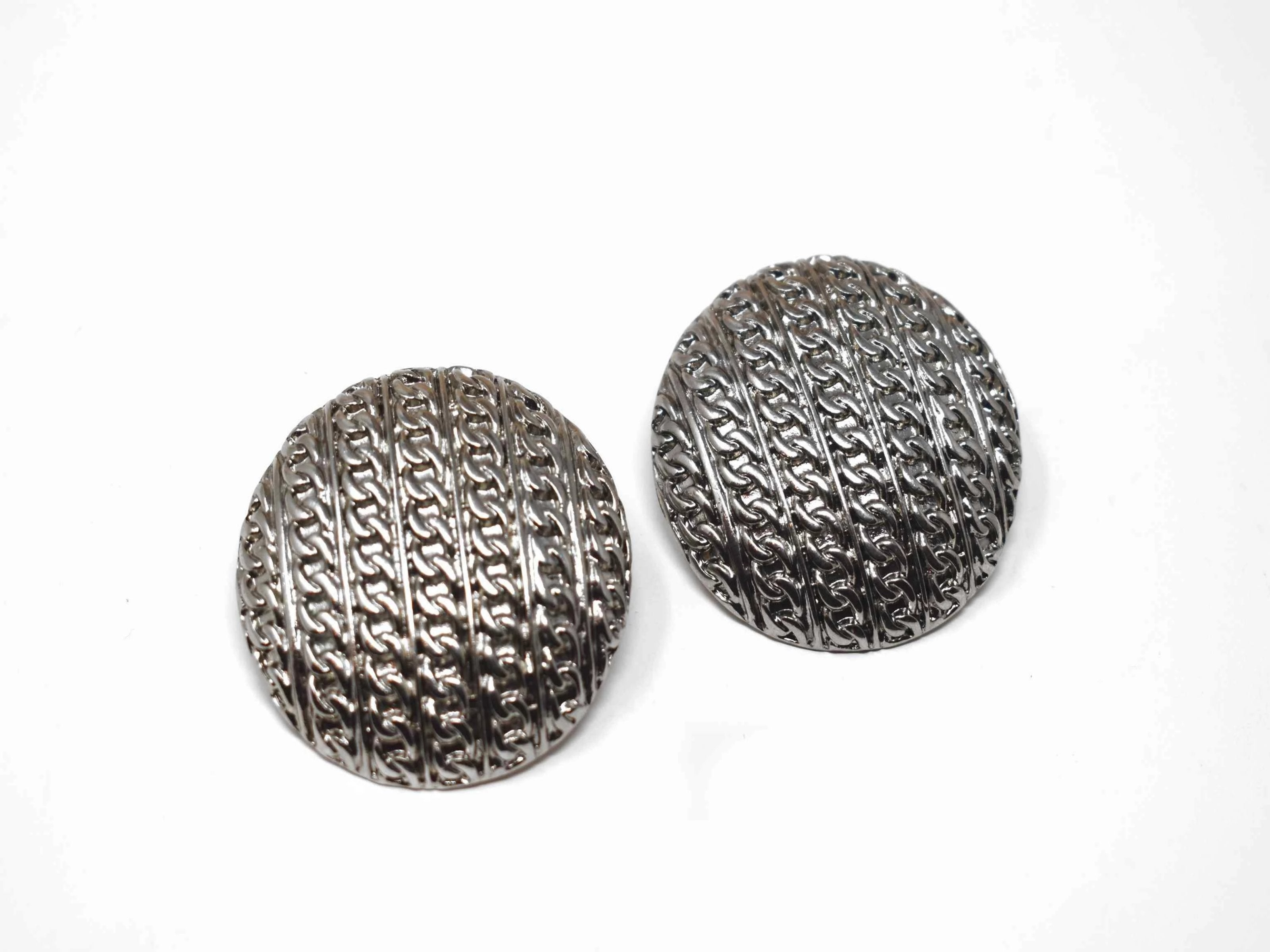 "Create a buzz in these crocus silver earrings with that statement chain link design. These oversized button knob earrings measures an 1 1/2"" in length and has a push back clasp."