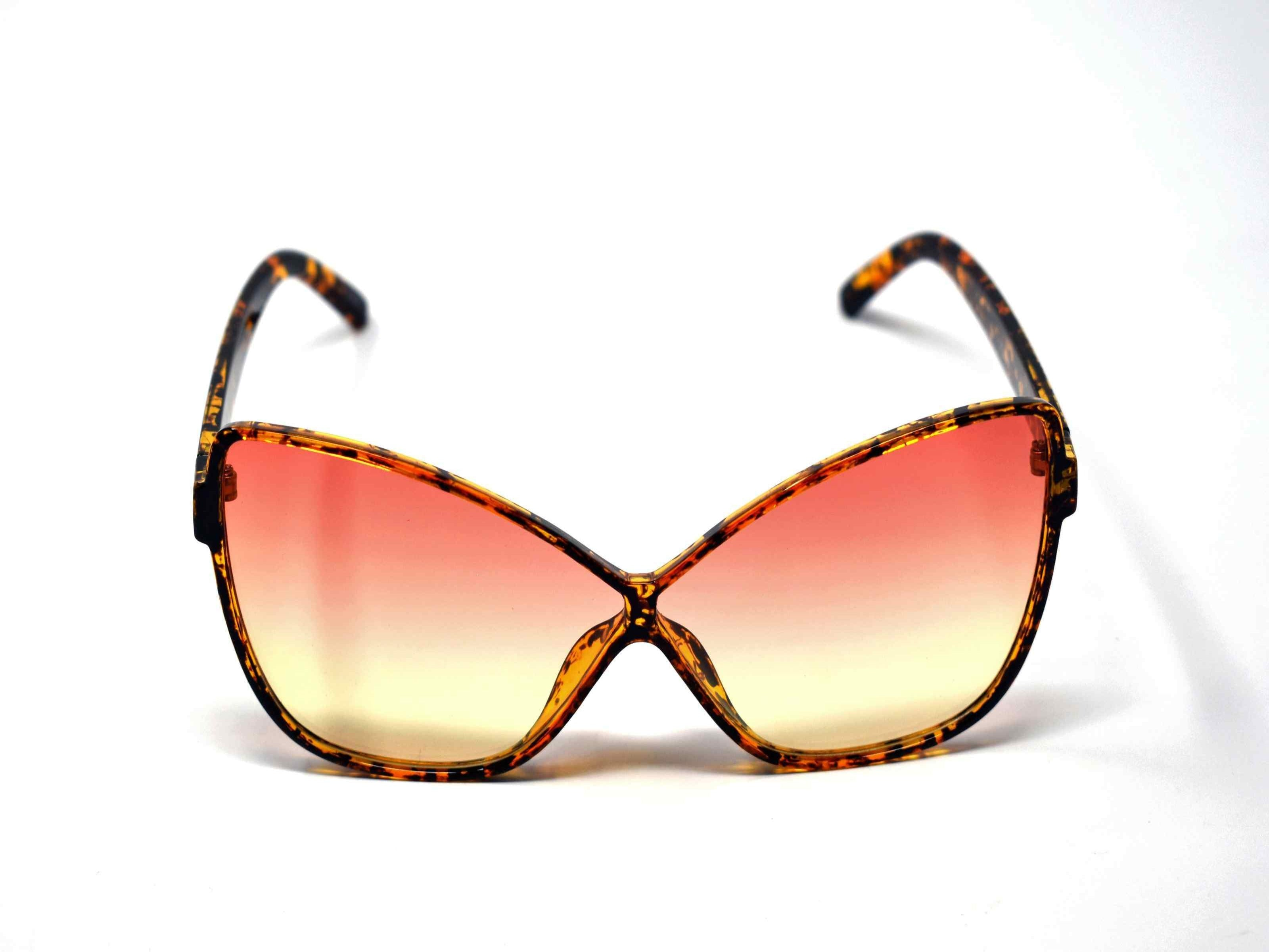 Our dahlia leopard tortoise cat eye frame with a orange to yellow ombre lens should be considered a no brainer when adding a touch of eye catching style.
