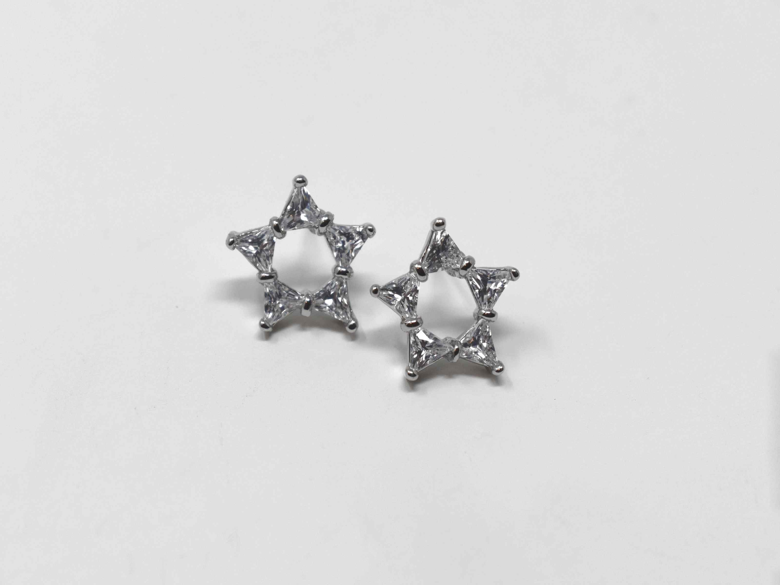 These Dianella earrings are a must have staple. These beauties are a  silver star shaped knob earrings encrusted in stones. They are a 1/2 inch in length with a pushback clasp.