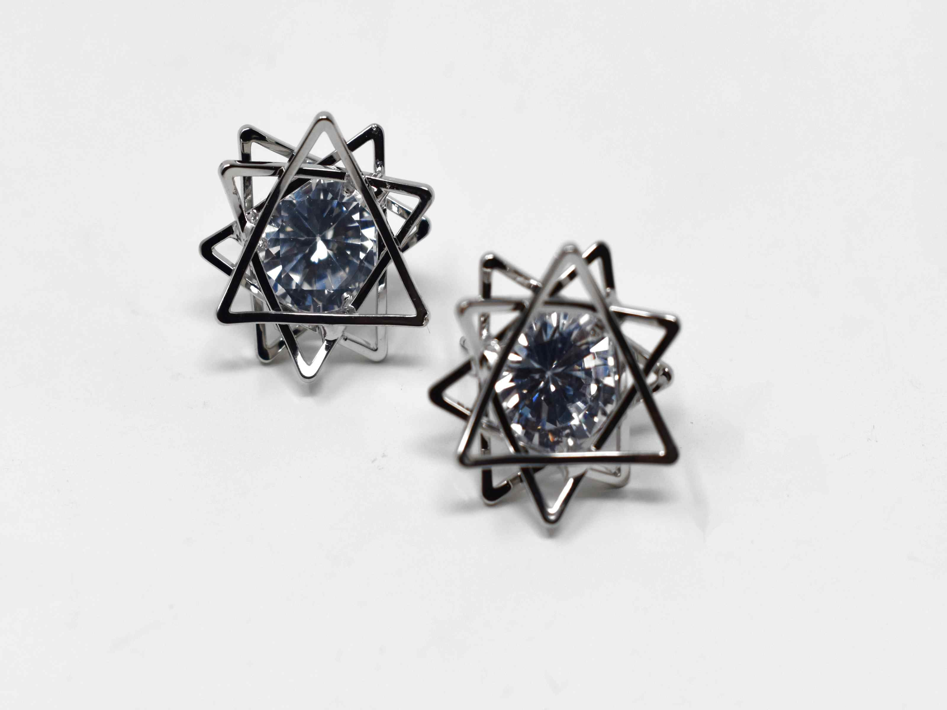 Dress up or dress down for any occasion  with our echium earrings. These silver earrings are a silver star flower knob earring with a centered stone. they have a push back clasp and are 1/2 inch in length.