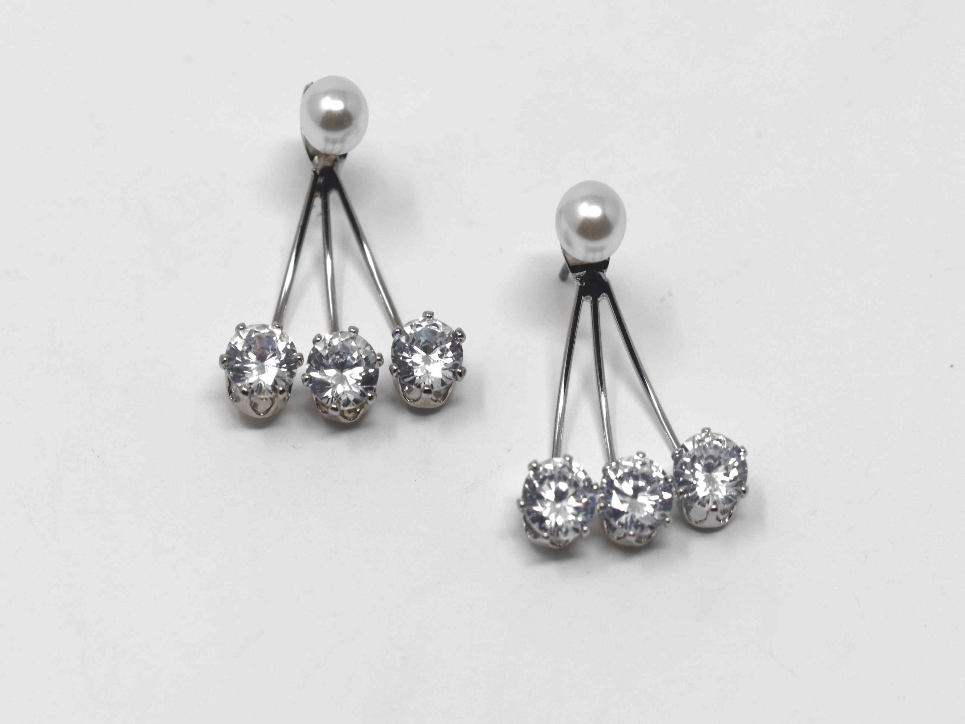 Make a statement with our on trend Erigeron earrings. These silver chandelier knobs have a pearl core with a cascade of stones. They are 1 inch in length with a push back clasp.