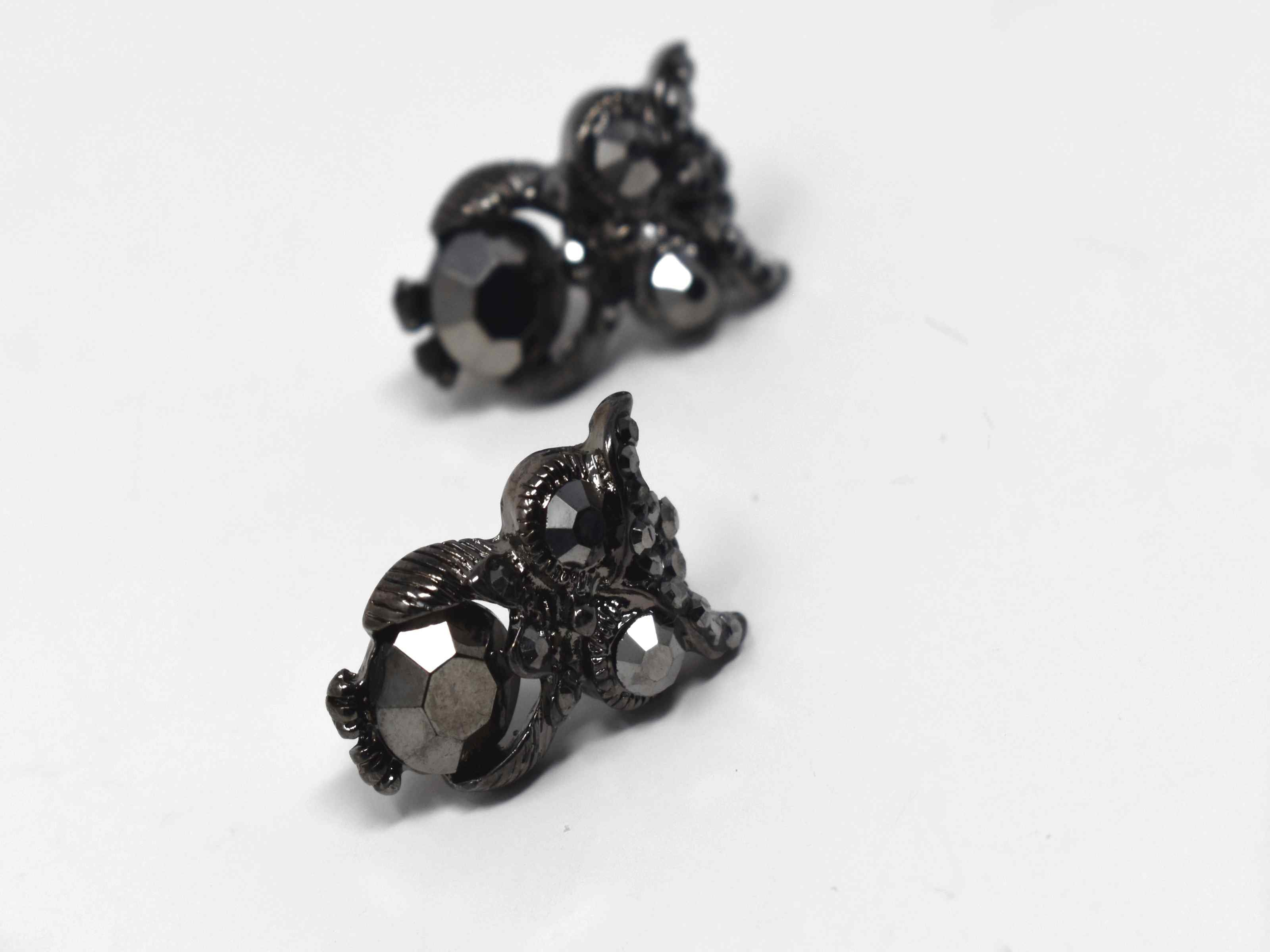 Our forget me not dark silver colored earrings are absolutely on trend. These owl design knob earrings have a push back clasp and is 3/4 of an inch in length.
