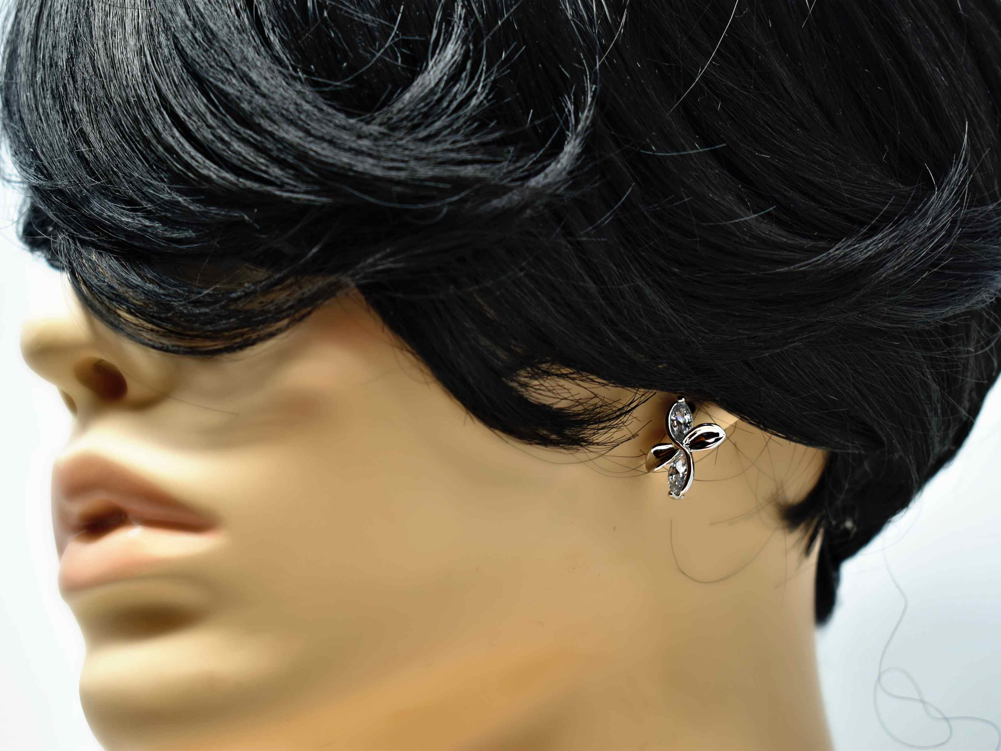 Our delicate and chic frangipani earrings are so versatile to help walk you through your style journey. They are a silver tone knob earrings with silver stones and a  push back clasp.
