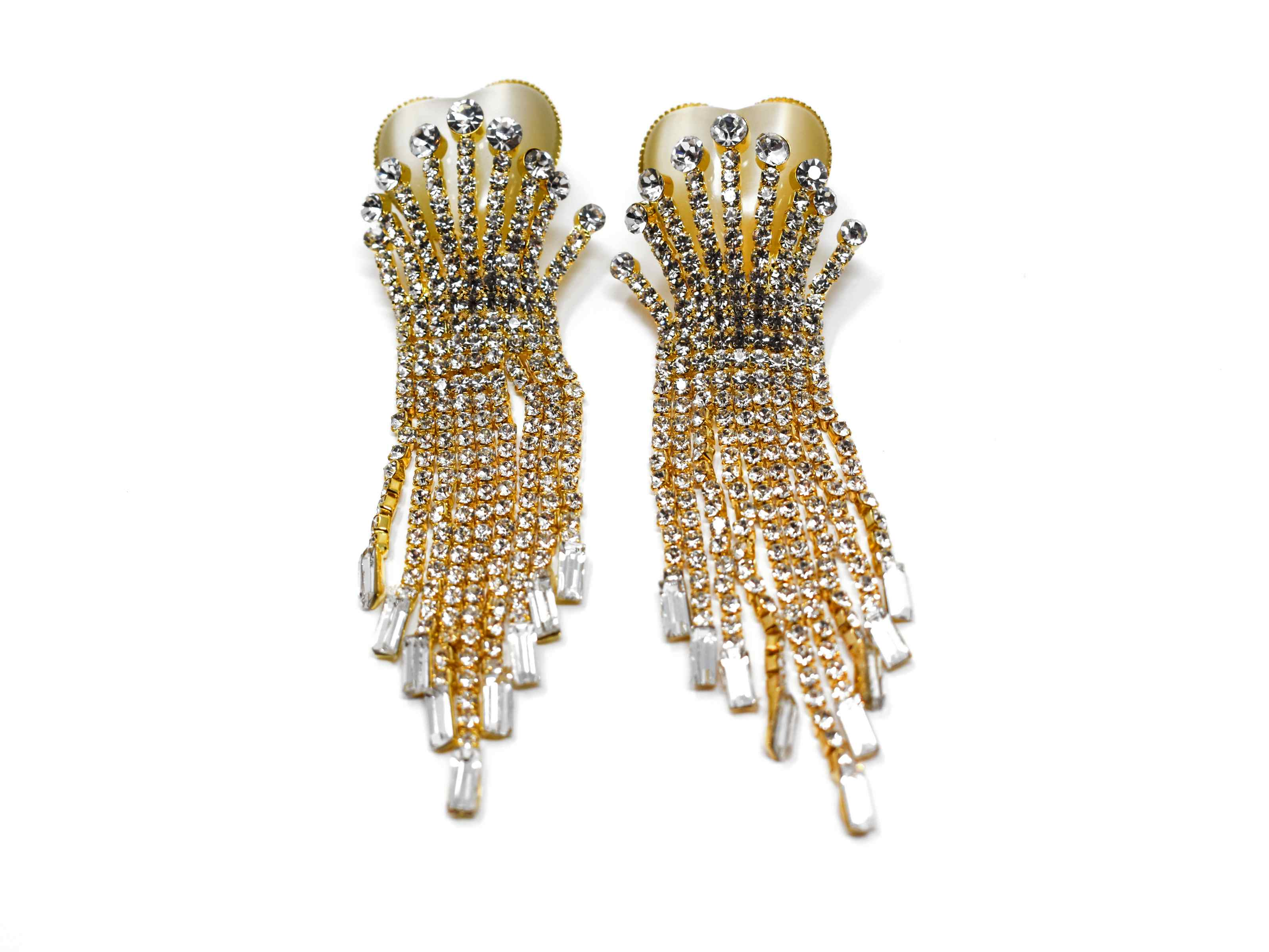 Gaillardia Brilliantly stoned Gold with clear stone detail over its heart shaped base is a wonderful addition your wardrobe. It is 3 1/2 inches in length with a push back clasp.