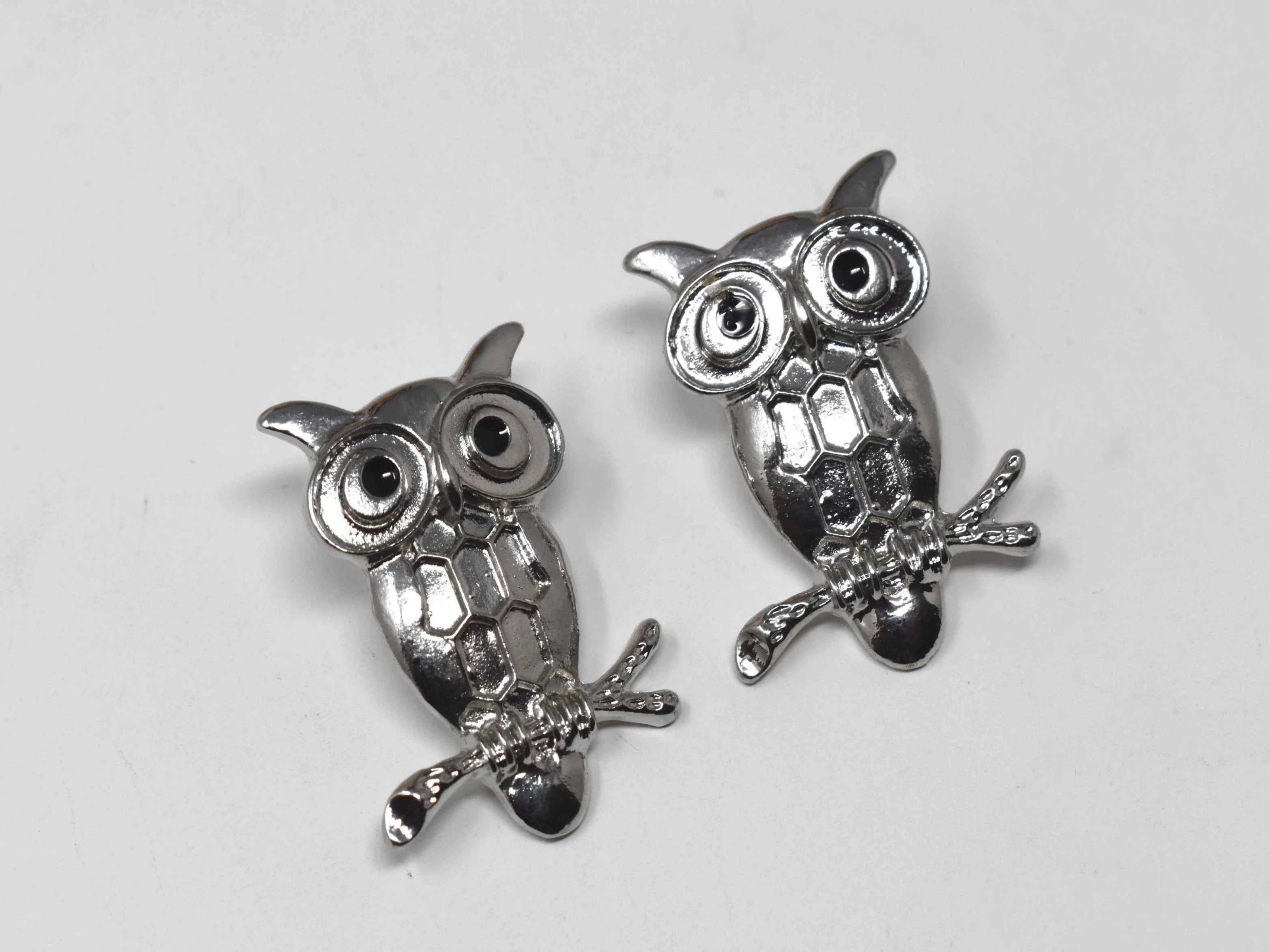 "Jazzy's whimsical silver owl shaped earrings has a push back clasp and measures 1 1/2"" in length.  Silver Tone 1 1/2 in length"
