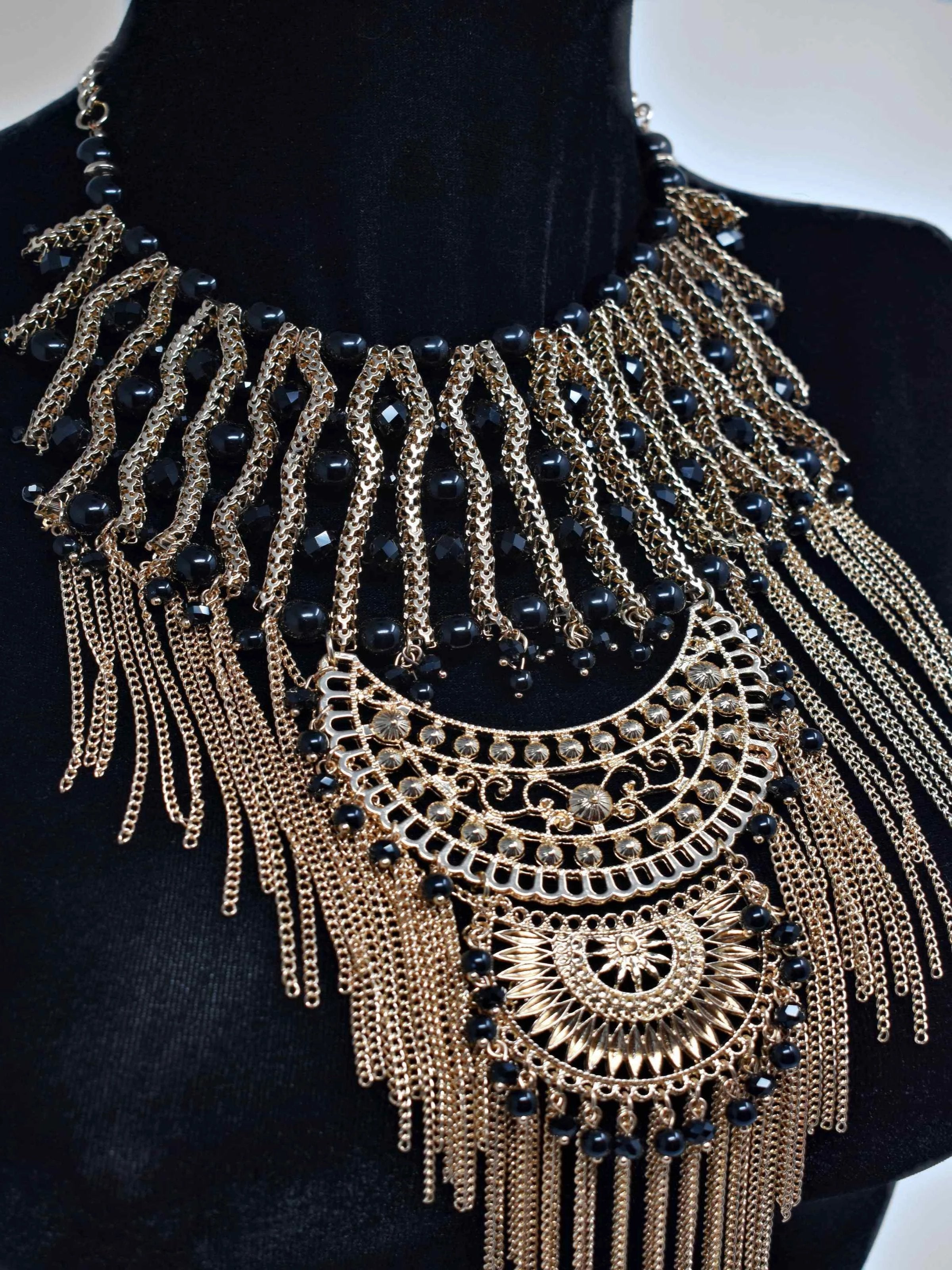 "Dare to dazzle with this radiant Onia Gold and Black statement necklace. This gold and black pearl fringe necklace is 19"" in length and lobster clasp."