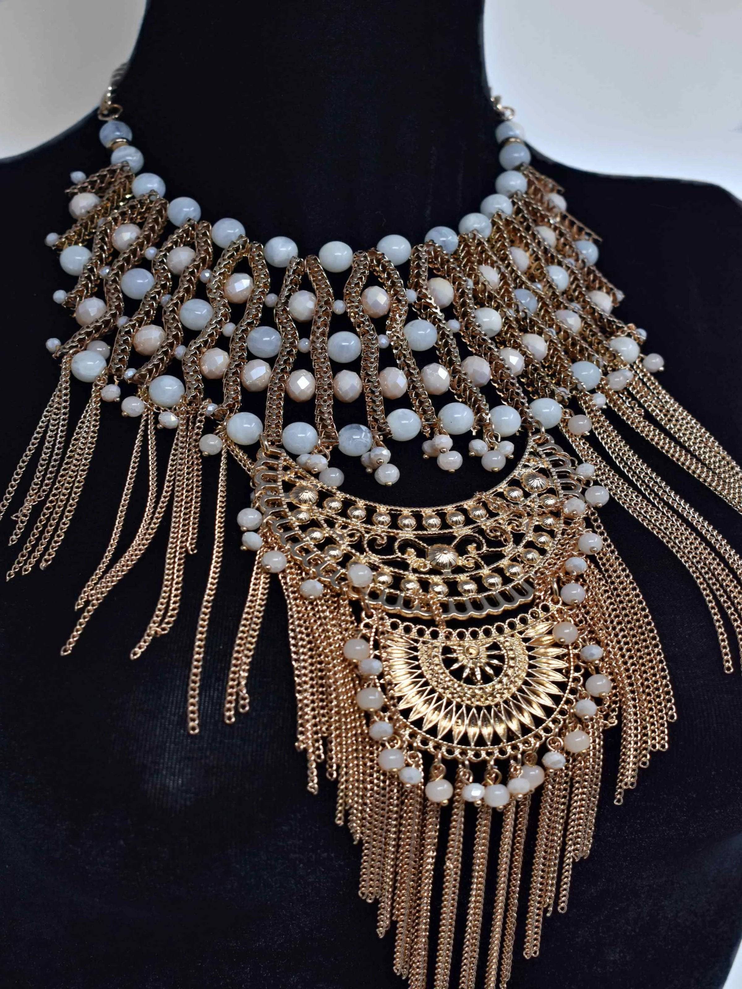 "Dare to dazzle with this radiant Onia Gold and Cream statement necklace. This gold and cream pearl fringe necklace is 19"" in length and lobster clasp."