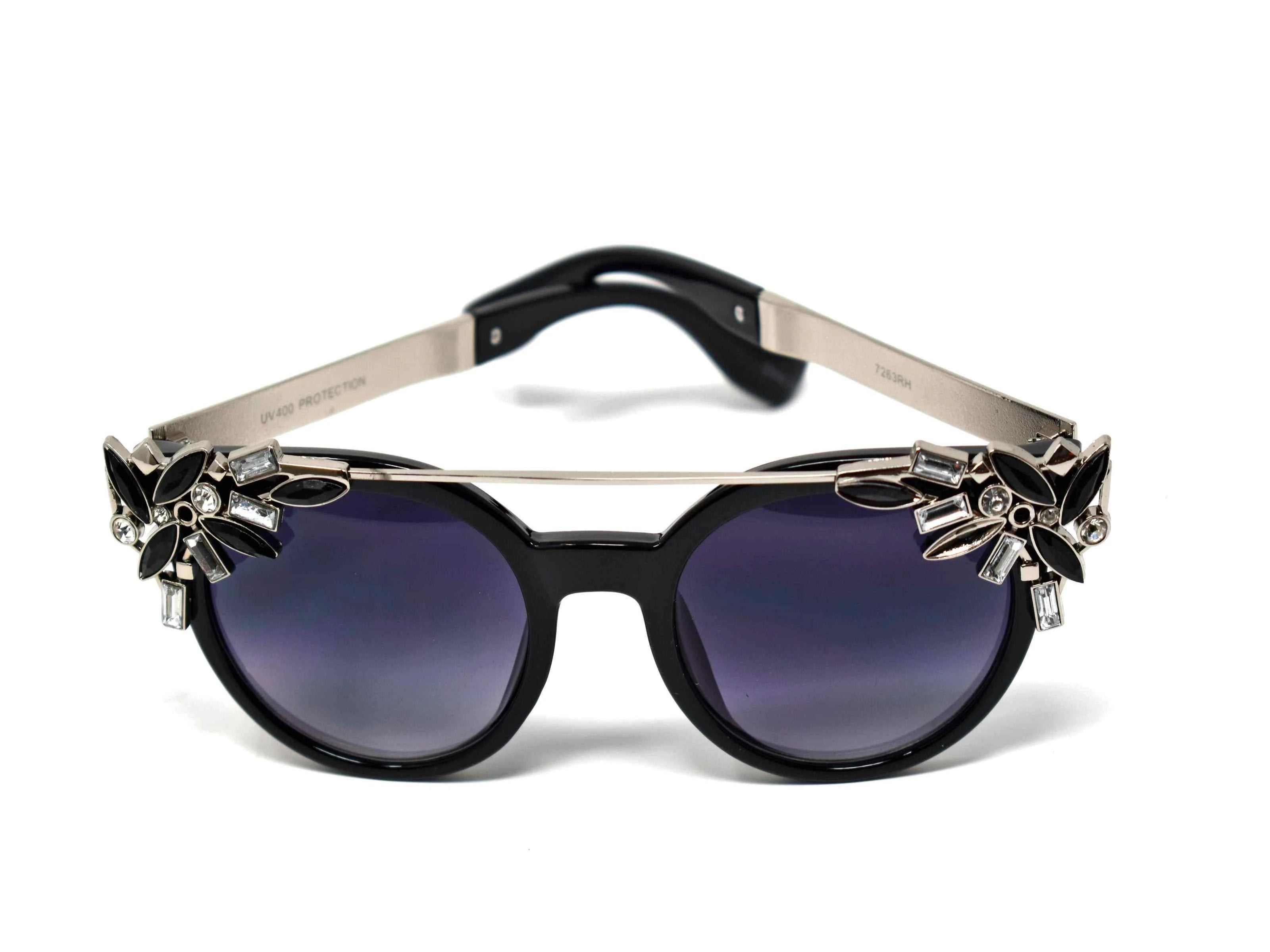 Trend setter and attention getter is what they will call you in these Pansy black sunglasses with a sleek silver trim adorned in black and clear gems, in a pantos style frame.