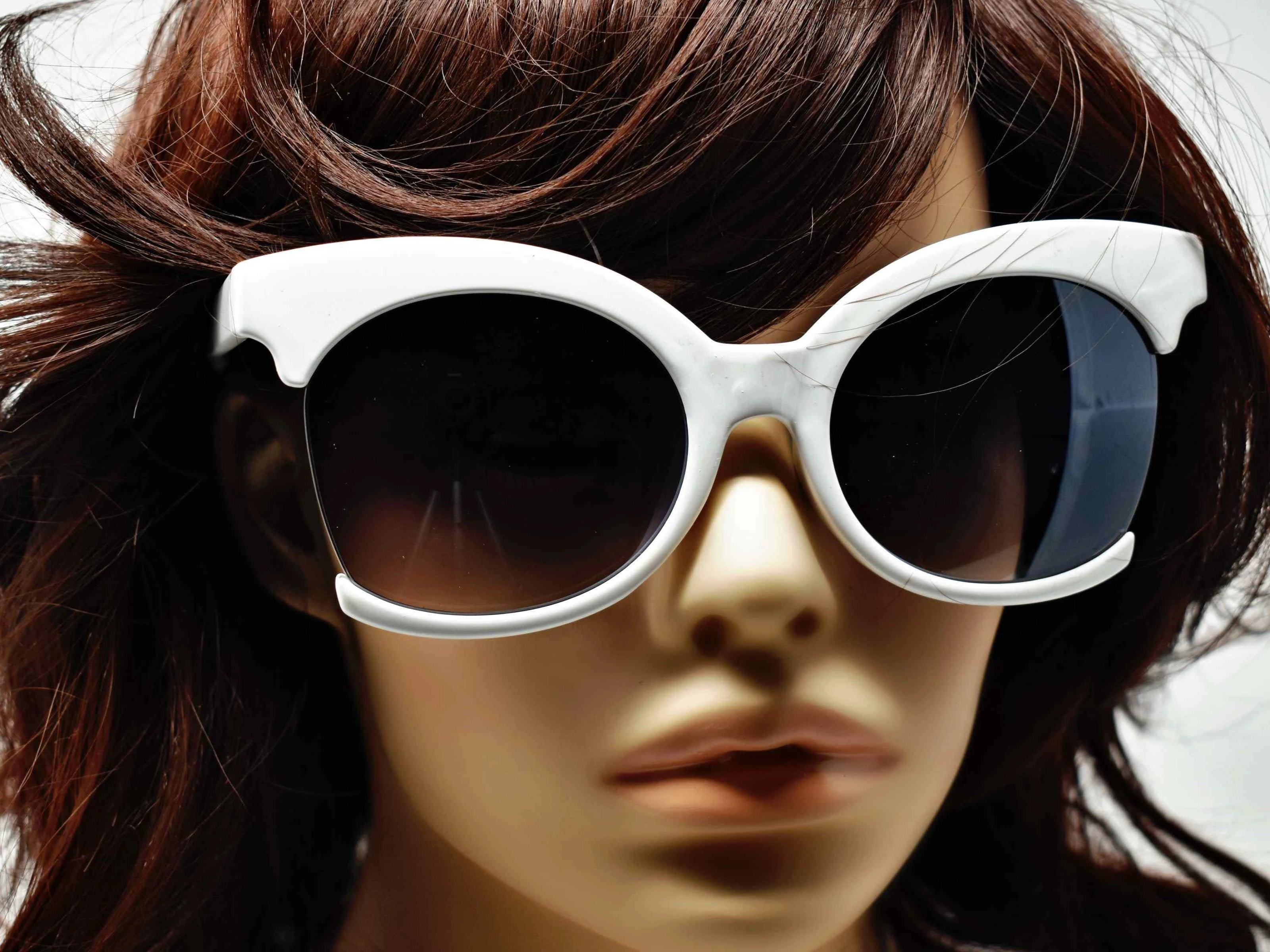 Be bold in our cutting edge primrose white cut out frames with a black lens.