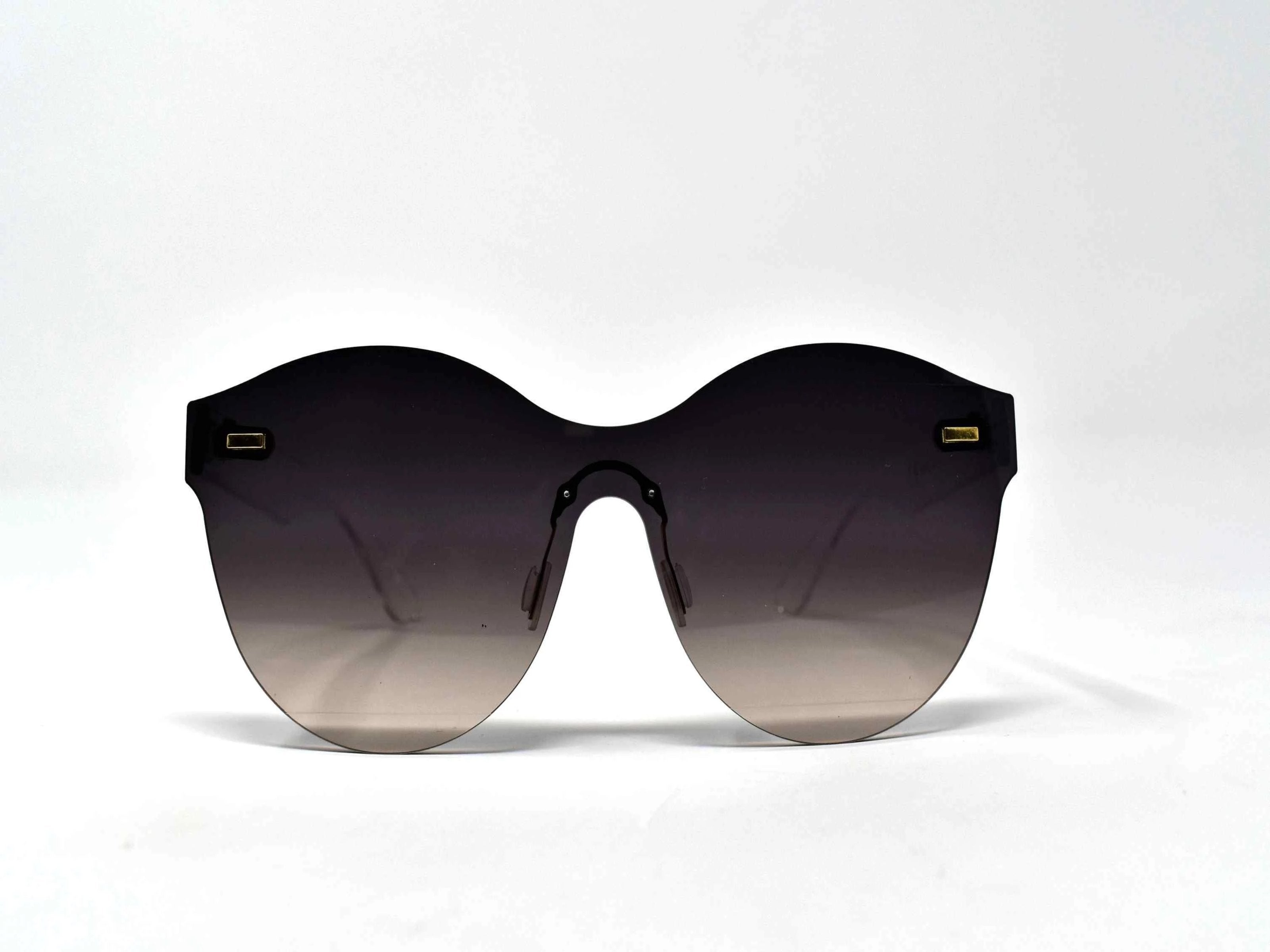 Its just a good vibe in these sage no rim sunglass frames with a black to gray ombre lens.
