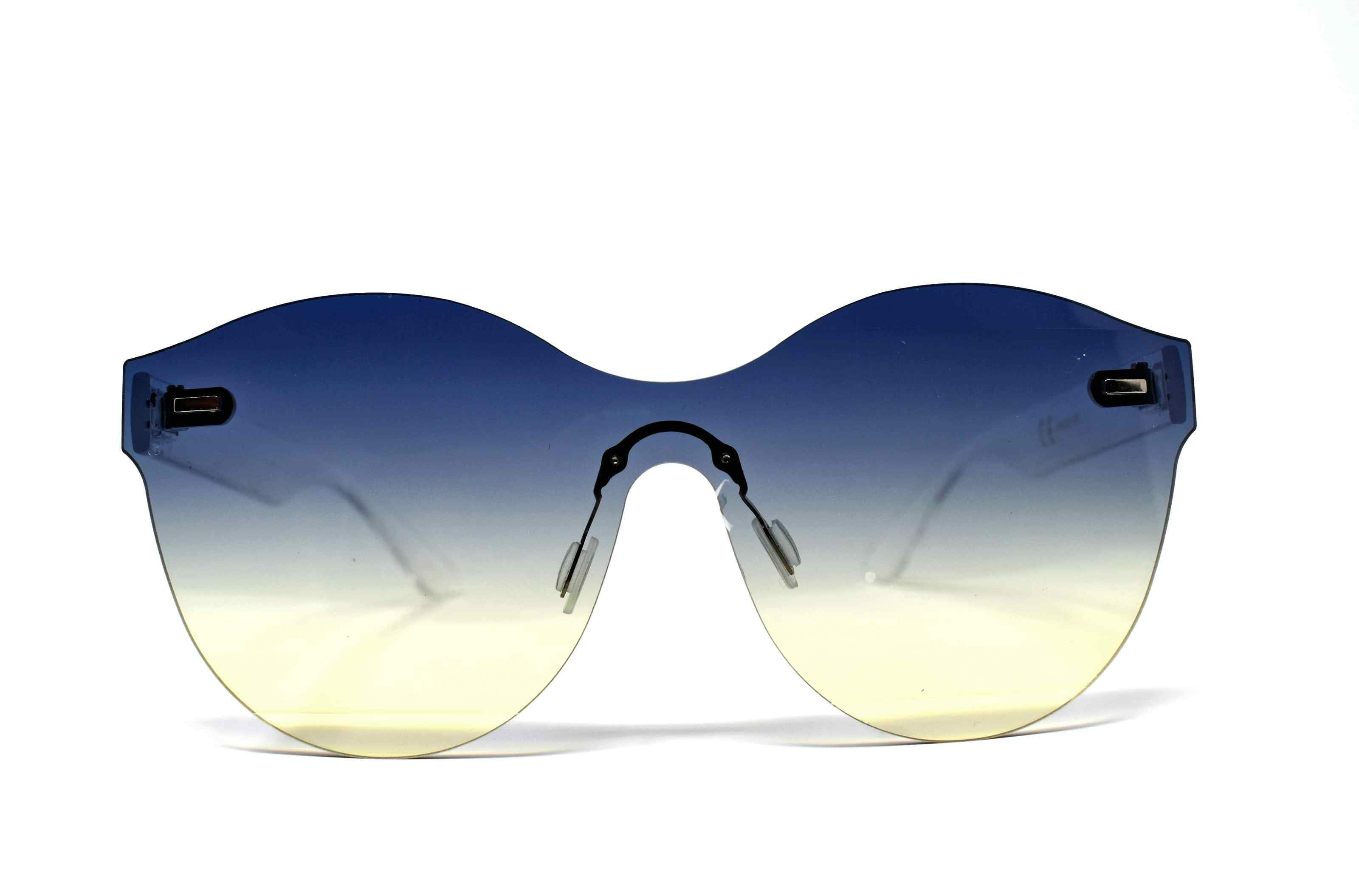 Its just a good vibe in these sage no rim sunglass frames with a blue to cream ombre lens.