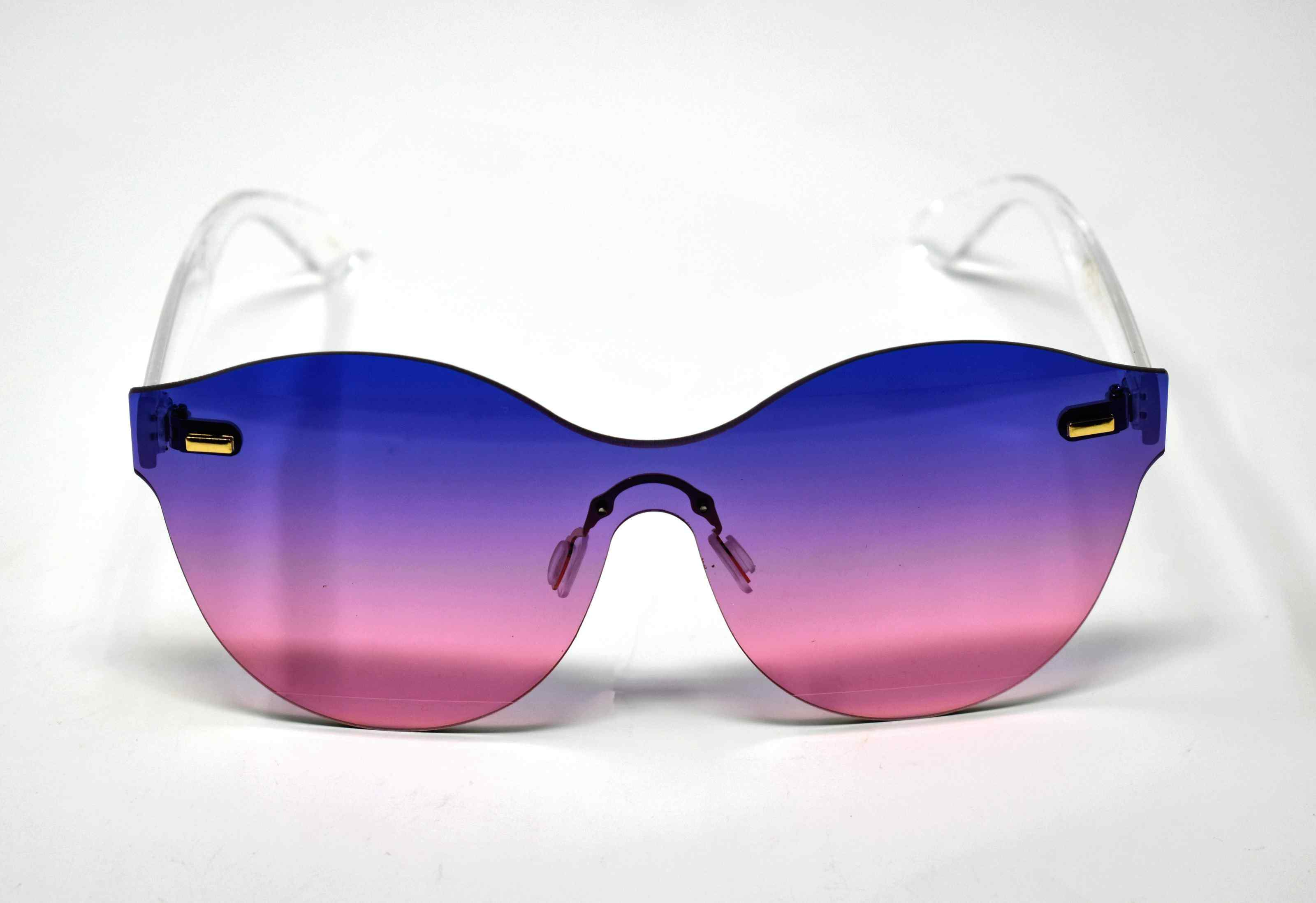 Its just a good vibe in these sage no rim sunglass frames with a purple to pink ombre lens.