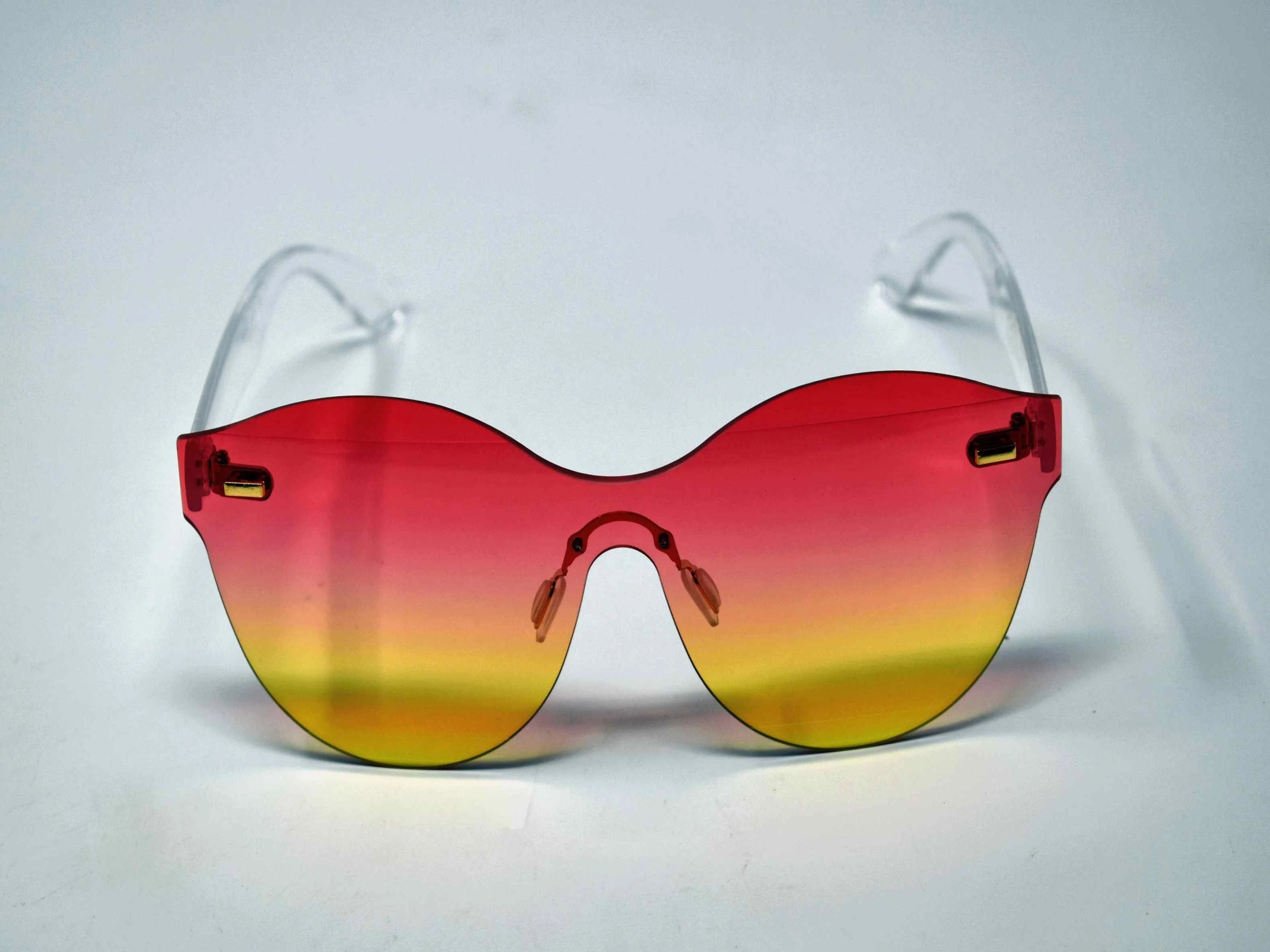 Its just a good vibe in these sage no rim sunglass frames with a rose pink to yellow ombre lens.
