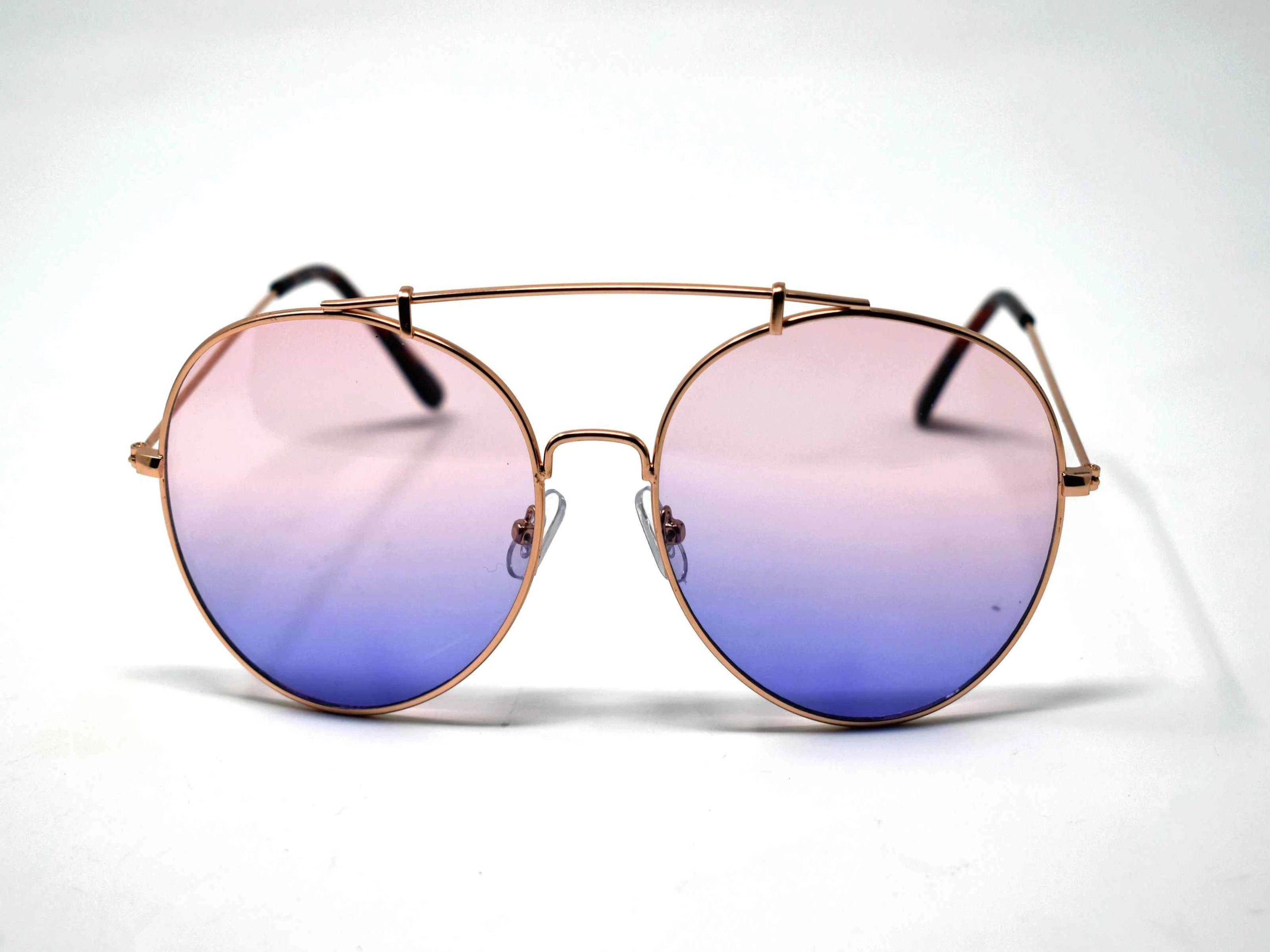 Va Va Voom will be consistently heard in these Vervain gold frame aviator Pink and Blue ombre lens sunglasses.