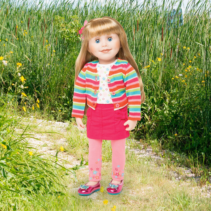 18 inch doll wearing bright striped sweater, pink skirt, lace top, pink leggings, colourful shoes.