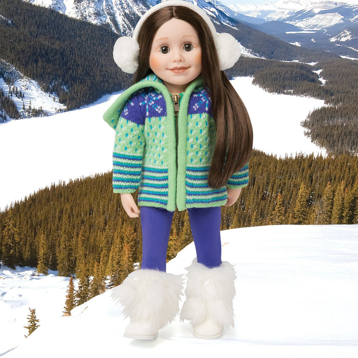 Apres ski green and purple sweater, purple tights, and white fluffy earmuffs. Fits all 18 inch dolls. Shown with white fluffy Maple Lodge boots on a snowy Banff background.