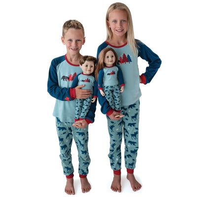 Boy, girl and 18 inch doll wearing matching family pjs, pyjamas, pajamas