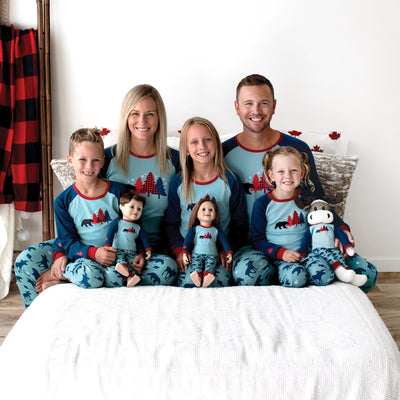 Man, woman, boy, girls and 18 inch dolls wearing matching family pajamas pjs pyjamas