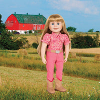 Brianne's starter outfit pink pants, pink patterned blouse, tan belt with sparkly buckle and tan riding boots fits all 18 inch dolls. Shown on Manitoba farm background.