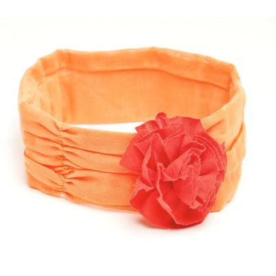 Orange cummerbund with flower fits all 18 inch dolls.
