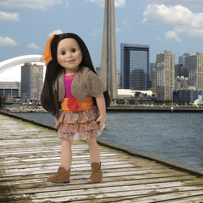 Colourful floral tiered skirt, silvery brown bolero sweater, bright pink top, orange cummerbund with flower, orange hair bow, brown suede-like booties fits all 18 inch dolls. Shown on Maplelea doll Alexi in a Toronto background.