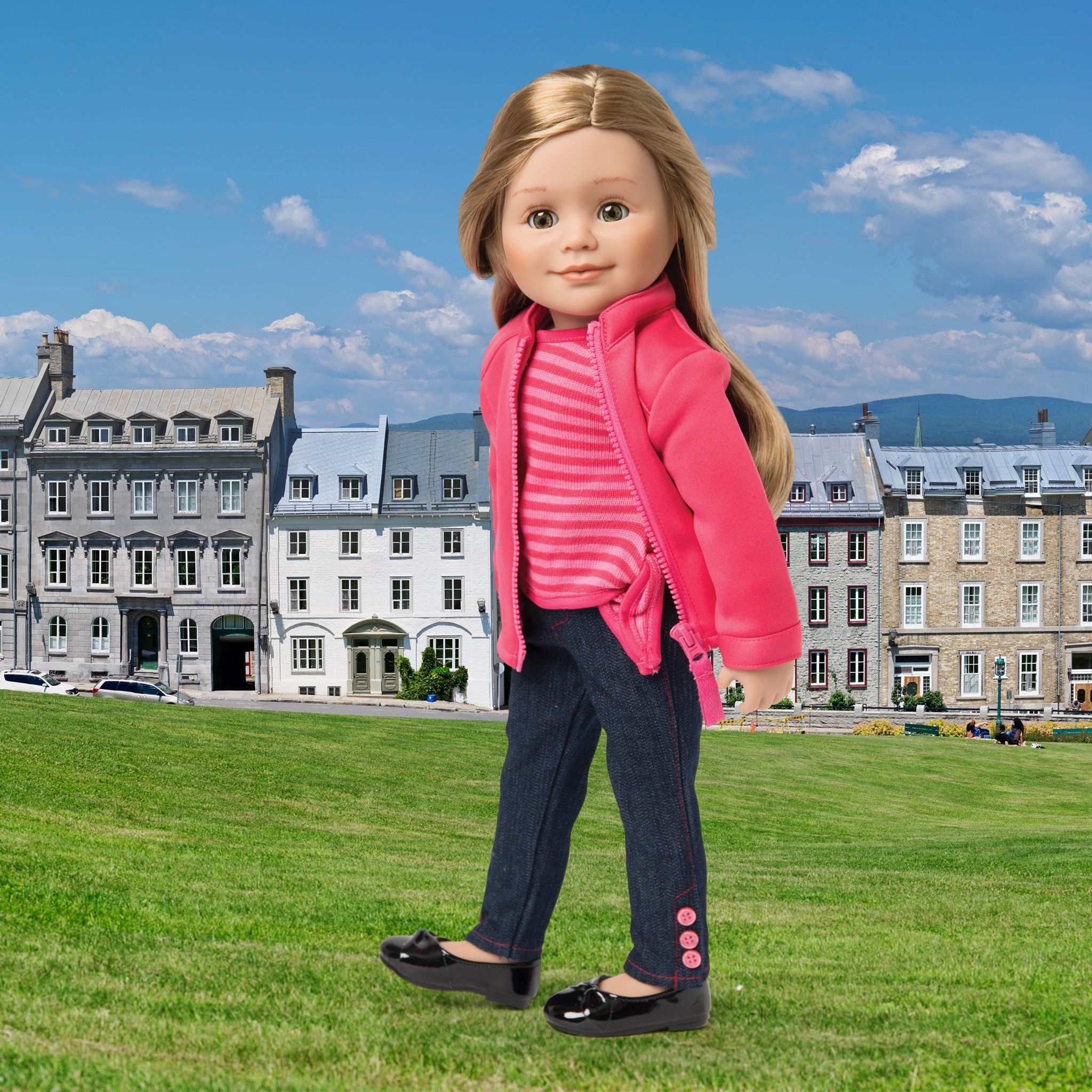 Cirque du Monde pink zip-up sweater, pink striped side-tie shirt, skinny jeans with ankle buttons shown on KL1 Leonie doll in Quebec background. Fits all 18 inch dolls.