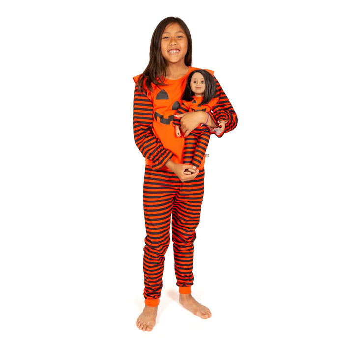 Matching girl and doll orange pumpkin PJs with black and orange striped pants.