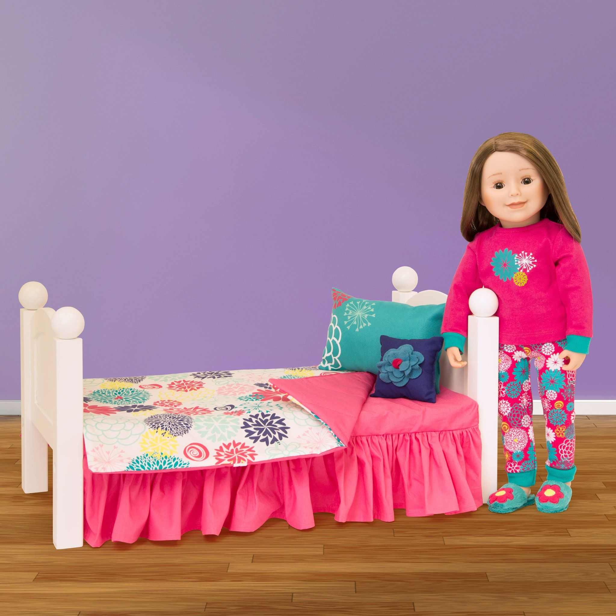 "Comforter, covered mattress with dust ruffle and two pillows shown with 18"" Maplelea doll and bed."