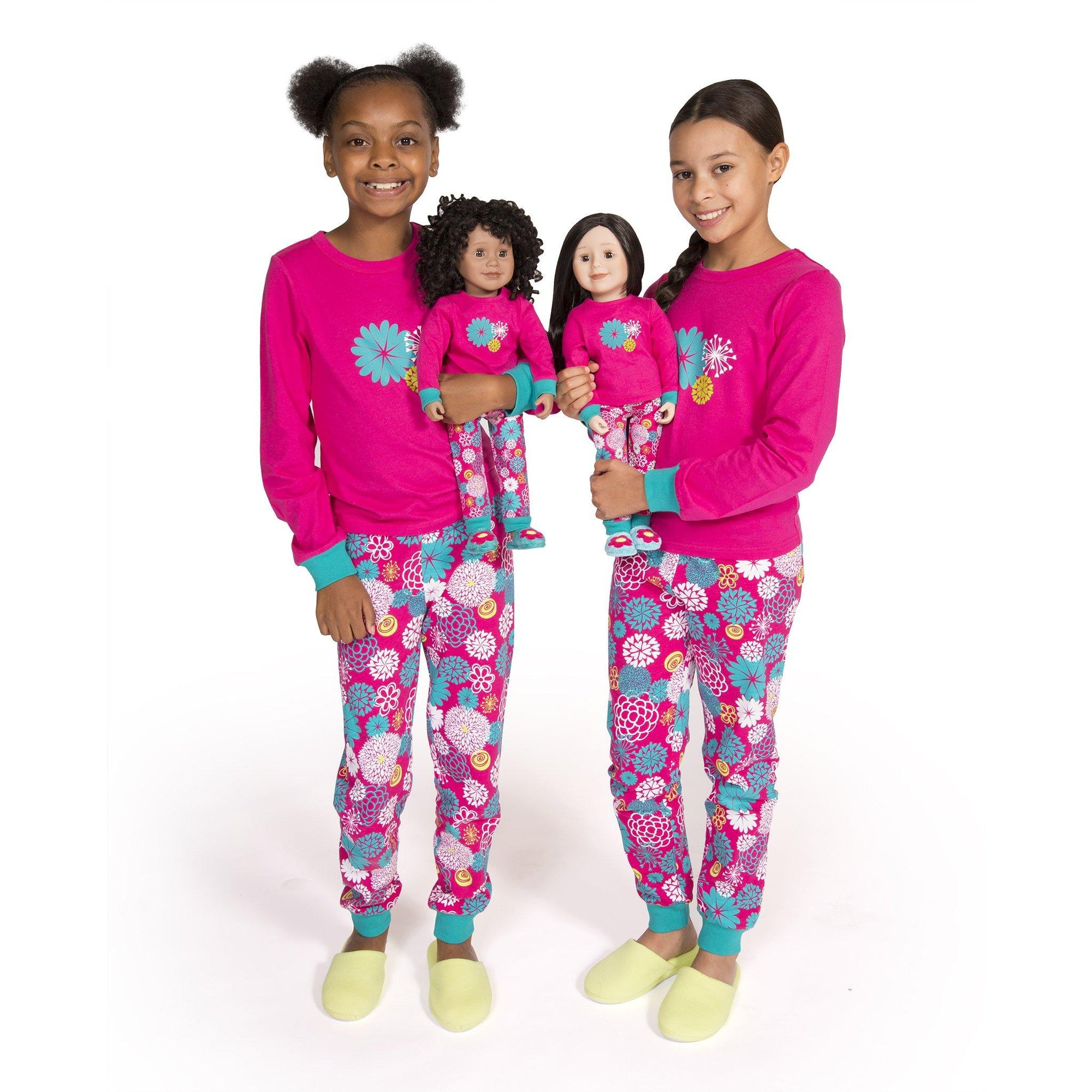 Two girls and two 18 inch dolls wearing matching pajamas from Maplelea Canadian Girl.
