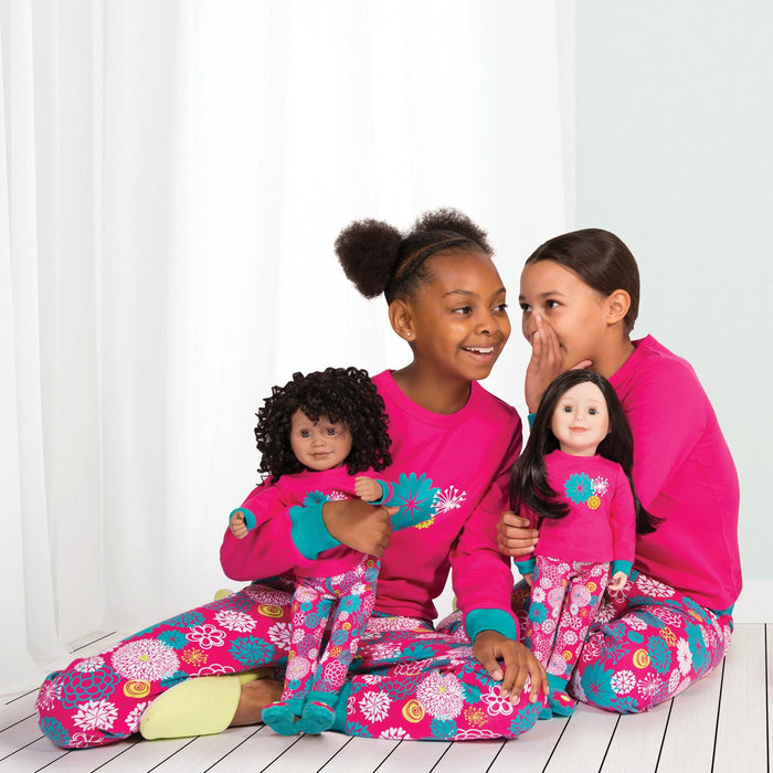 Two girls and two dolls wearing very high quaity matching pajamas from Maplelea