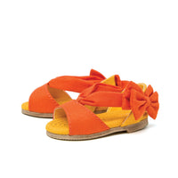 Flower Power orange bow sandals fit all 18 inch dolls.