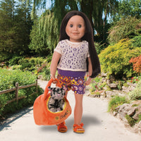 Summer outfit of shorts, top and sandals shown on 18 inch Alexi doll with plush cat and house.