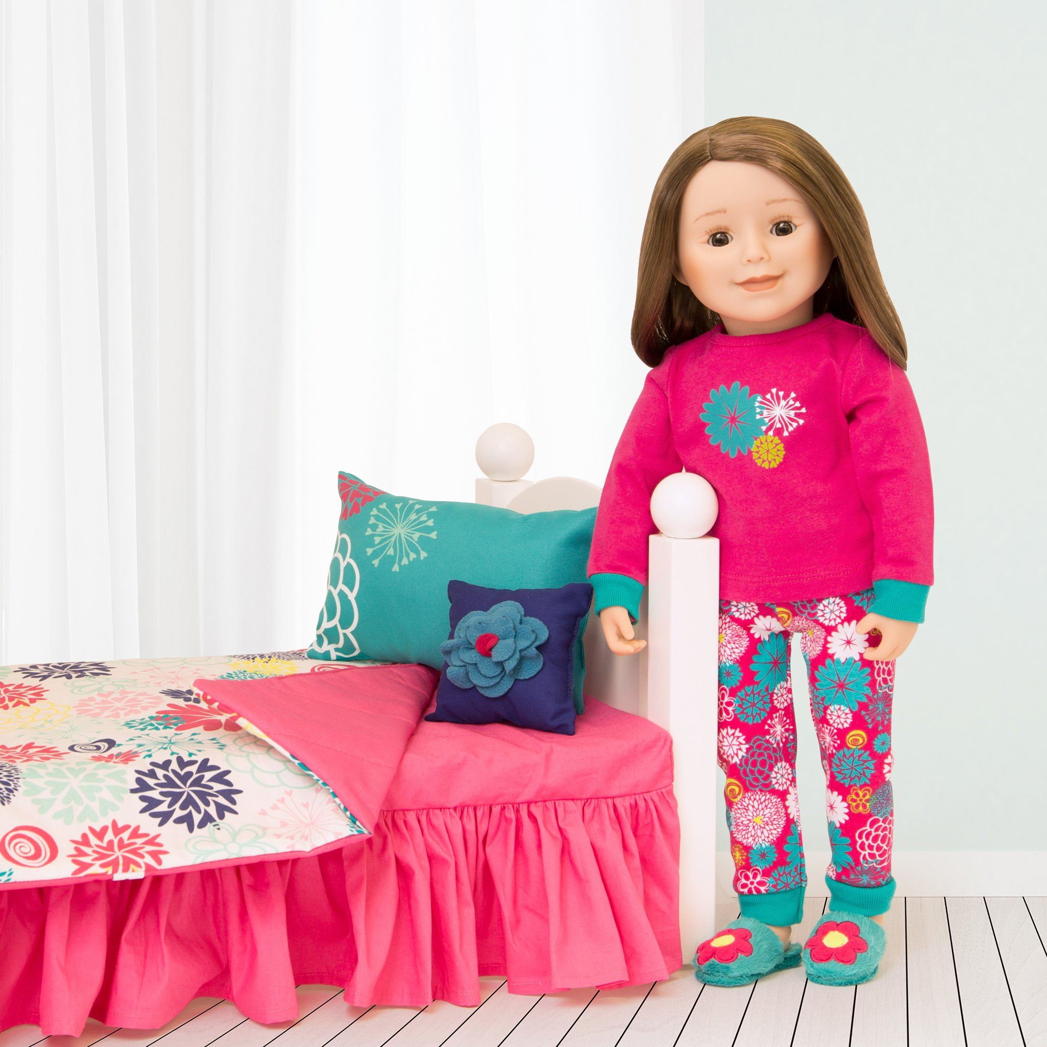 Matching pajamas for doll and girl.  Pink and teal PJs shown on 18 inch doll with bed and bedding.