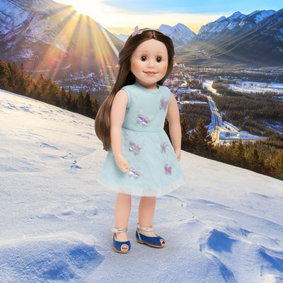 Layered dress with 3-D butterflies, silver headband and peep-toe sandals shown on 18 inch dolls.
