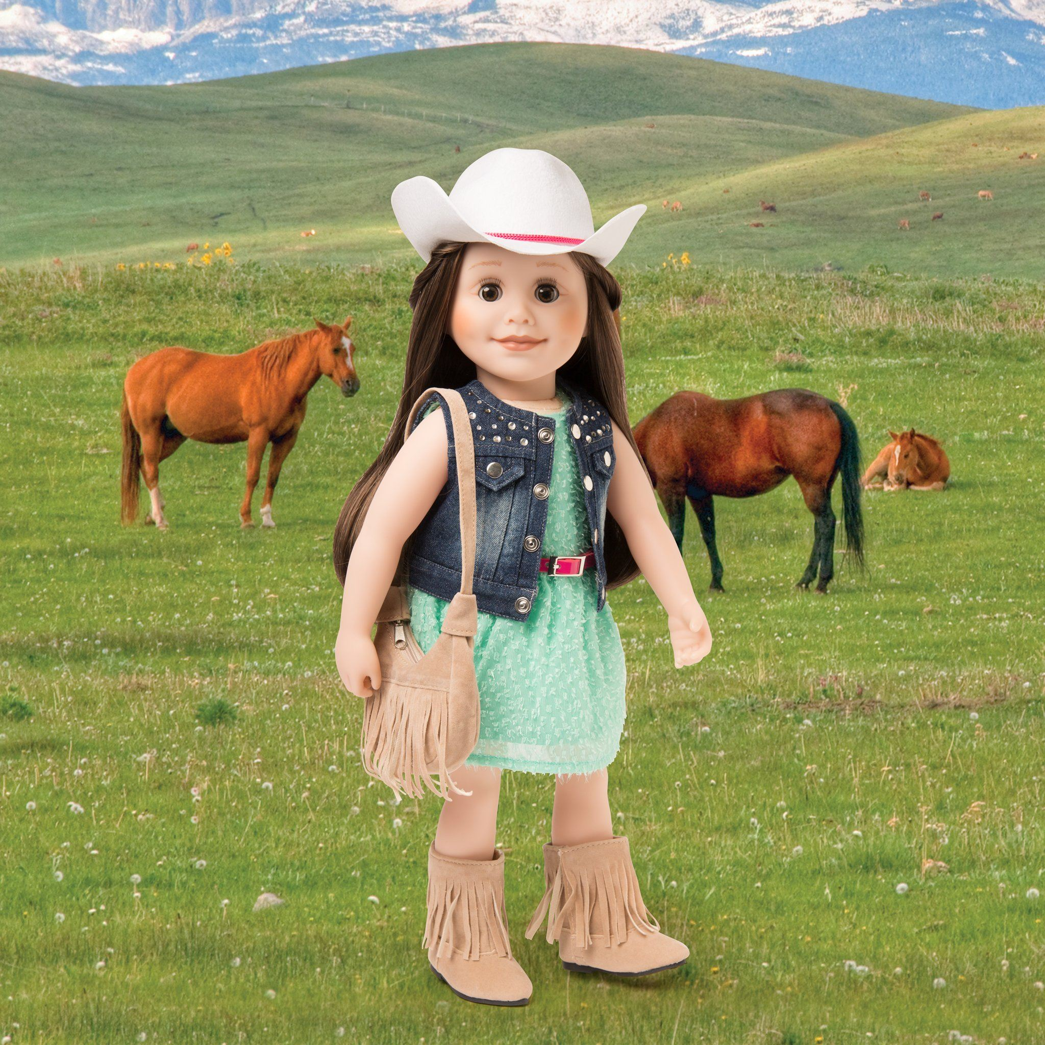 Western fringed purse and boot accessory set shown with Stampede Style outfit on 18 inch doll.