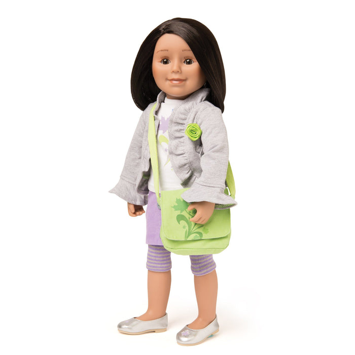 Light grey ruffle jacket has green ribbon rosette, with green messenger bag on 18 inch doll.