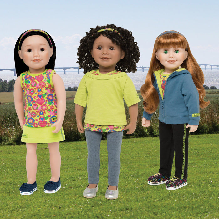 Two tops, two pants, one skirt, 2 tops, 1 jacket, three hairbands shown on three 18 inch dolls.