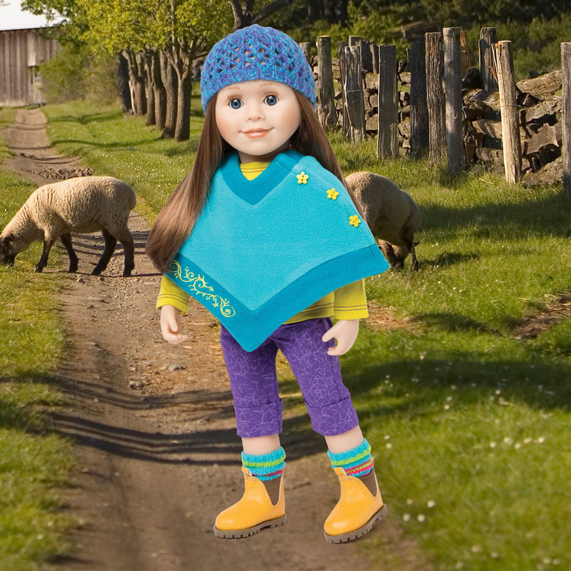 Gulf Island Stylin' teal poncho with green button detail, crochet hat, purple patterned capri pants, striped socks and ankle boots fits all 18 inch dolls.