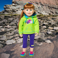 18 inch doll Jenna wearing brightly coloured running shoes called Cross Country Racers.
