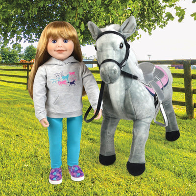 18 inch Canadian Girl doll wearing horse themed hoody with slip-on shoes aqua leggings beside her pony.