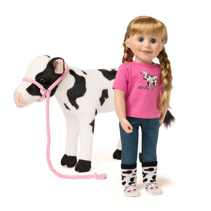 Plush poseable cow, pink t-shirt with cow graphic, denim jeans and cow-print socks fit all 18 inch dolls.