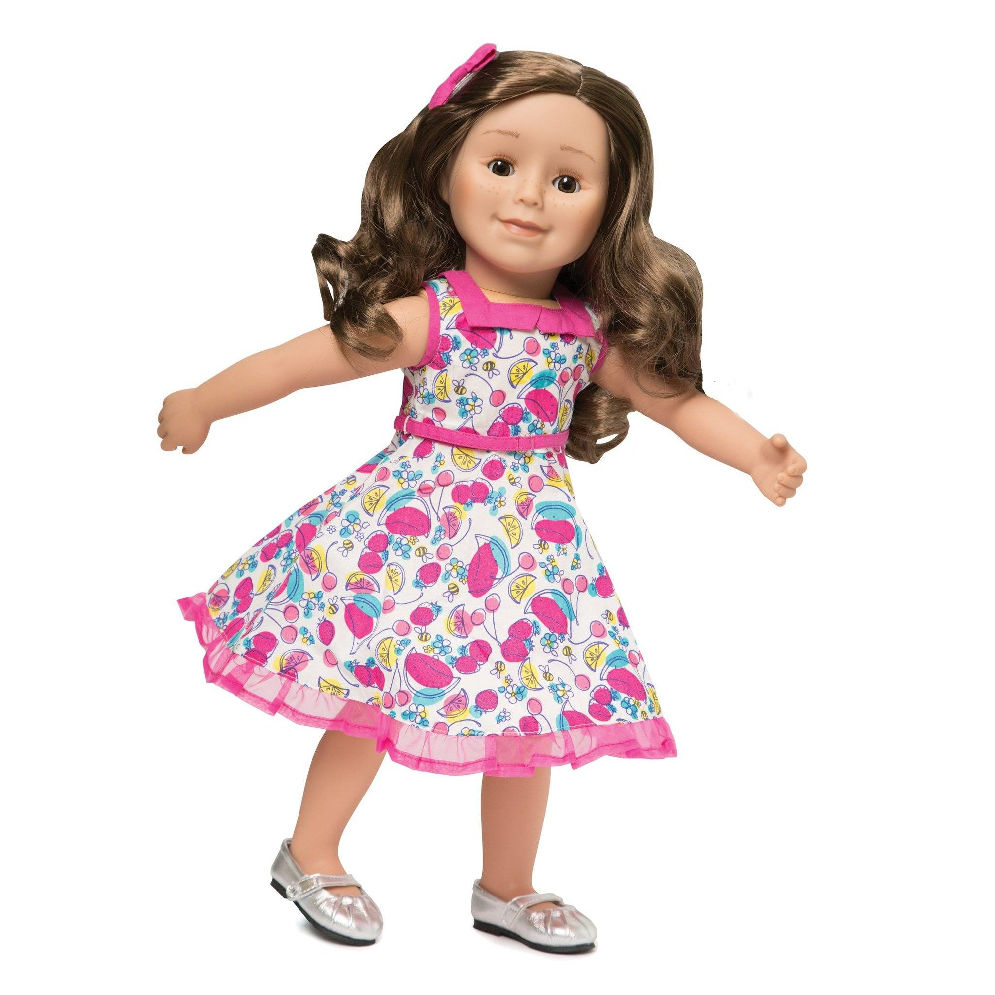 Standing Ovation white 50's inspired dress with multi-colour fruit print and pink accents and pink hair bow fits all 18 inch dolls.