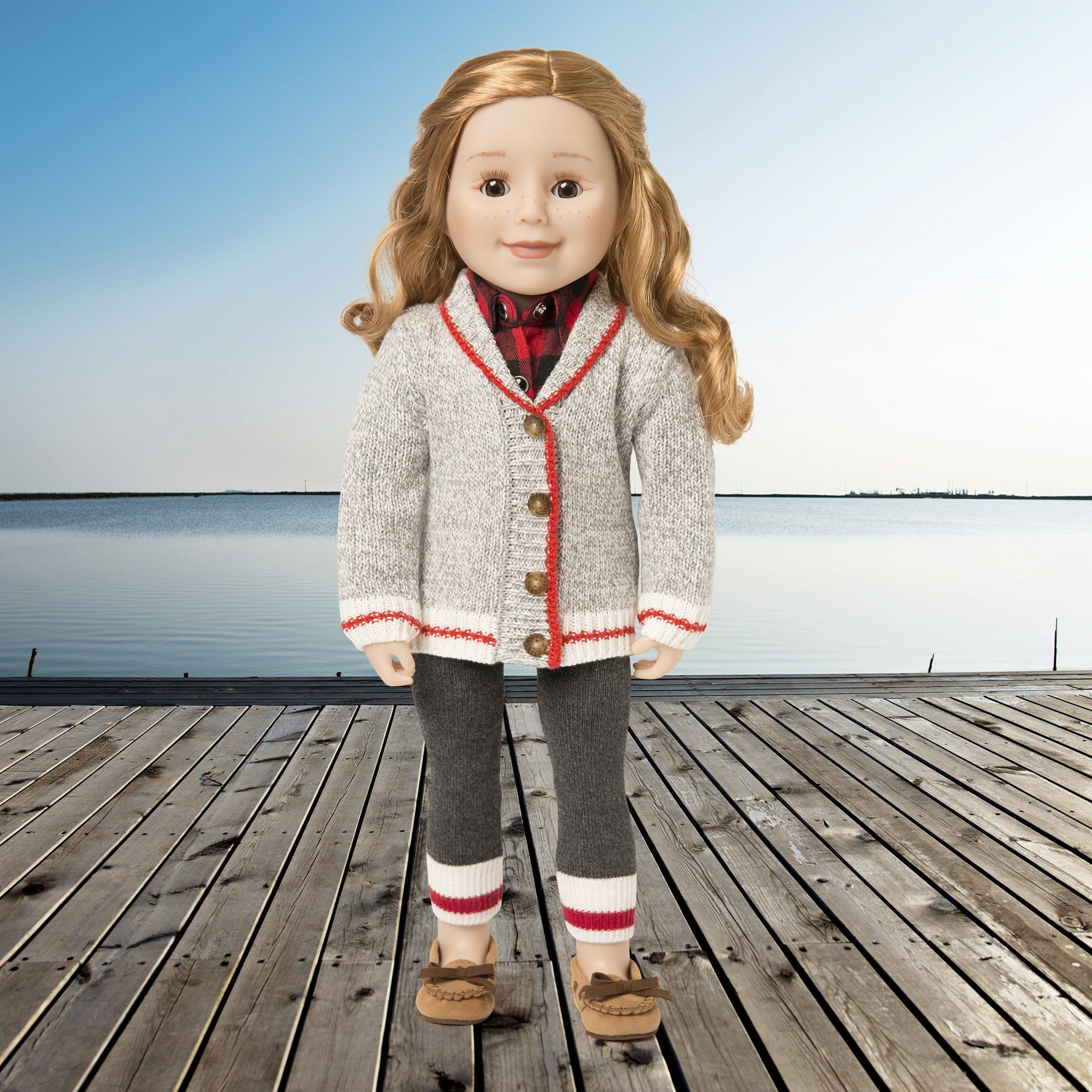 Doll showing her Canadian roots by wearing a classic red and grey sweater cardigan