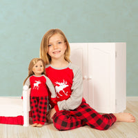 18 inch doll and girl wearing matching Canadian moose pajamas