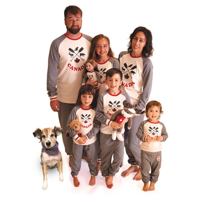 Family wearing matching pajamas.  Canadian design.  Adults, kids, 18 inch doll and bandana for dog.