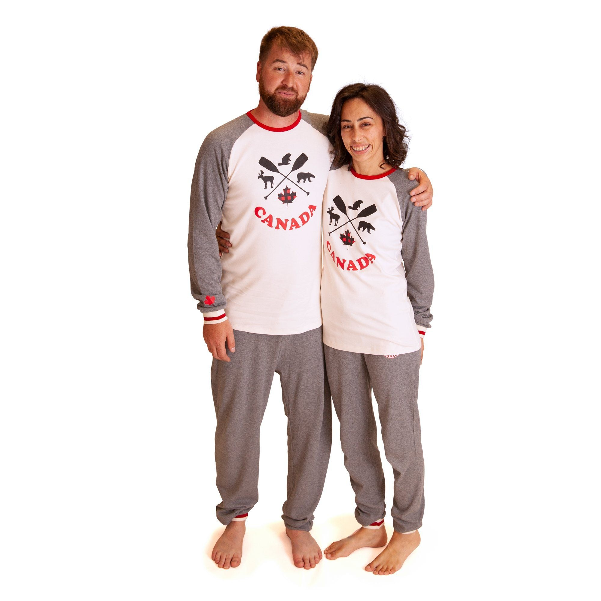 Man and woman in matching pjs, also match kids, toddlers, doll and dog